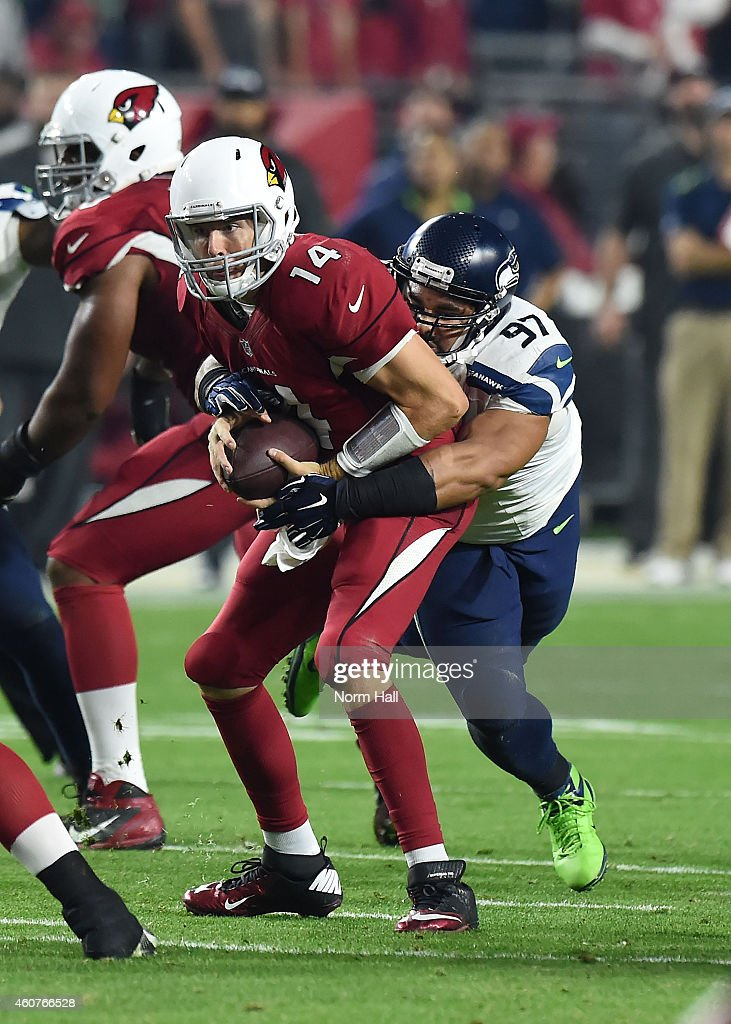 Defensive tackle <a gi-track='captionPersonalityLinkClicked' href=/galleries/search?phrase=Jordan+Hill+-+American+Football+Player&family=editorial&specificpeople=13503545 ng-click='$event.stopPropagation()'>Jordan Hill</a> #97 of the Seattle Seahawks sacks quarterback <a gi-track='captionPersonalityLinkClicked' href=/galleries/search?phrase=Ryan+Lindley&family=editorial&specificpeople=6235431 ng-click='$event.stopPropagation()'>Ryan Lindley</a> #14 of the Arizona Cardinals in the second half at University of Phoenix Stadium on December 21, 2014 in Glendale, Arizona. The Seahawks 35-6.
