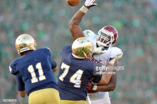 Defensive tackle Jordan Phillips of the Oklahoma Sooners blocks a pass from quarterback Tommy Rees of the Notre Dame Fighting Irish on September 28...