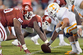 Defensive tackle Jordan Phillips of the Oklahoma Sooners stares up at center Mack Crowder of the Tennessee Volunters during first half action of...