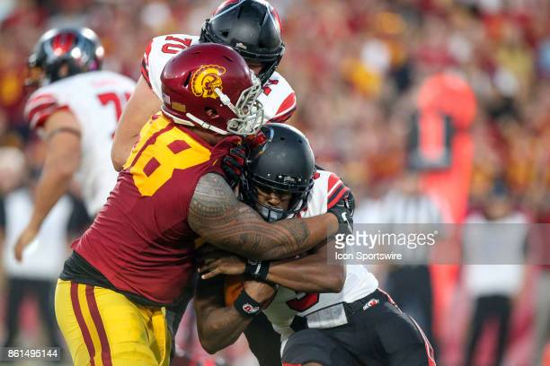 defensive tackle Josh Fatu of the USC Trojans sacks quarterback Troy Williams of the Utah Utes for a loss in a game between the Utah Utes vs USC...