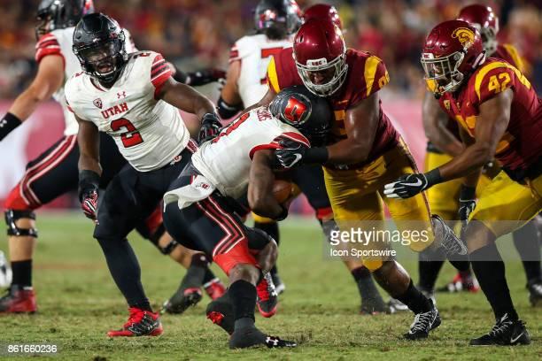 defensive tackle Josh Fatu of the USC Trojans sacks quarterback Troy Williams of the Utah Utes in a game between the Utah Utes vs USC Trojans on...