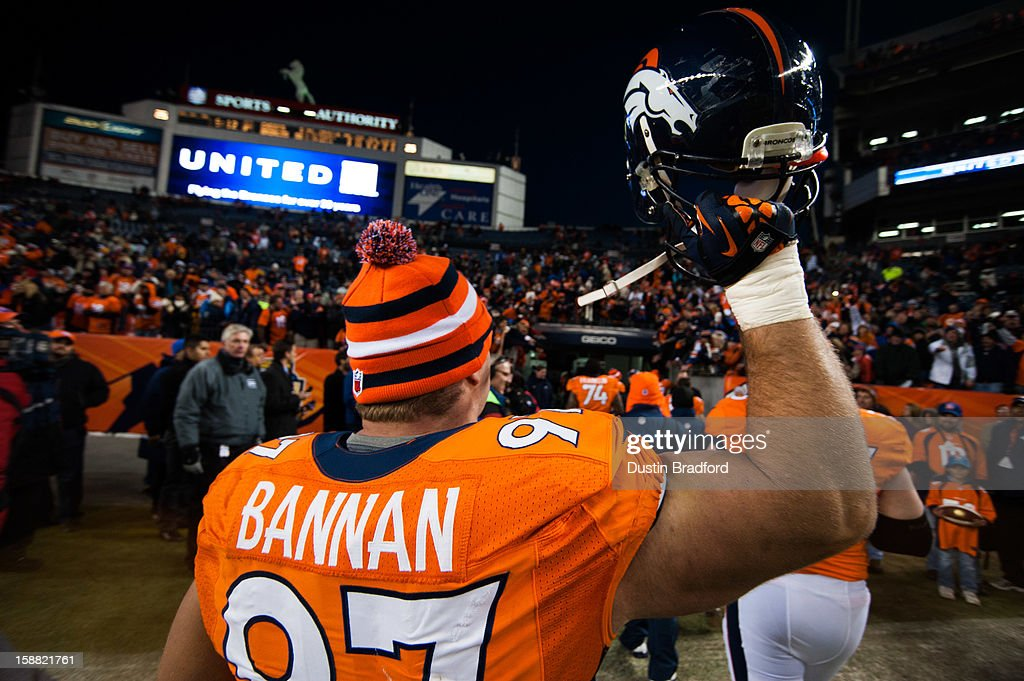 Defensive tackle Justin Bannan #97 of the Denver Broncos holds his helmet in the air as he walks off the field to loud cheers after securing the #1 seed in the AFC Playoffs after a game against the Kansas City Chiefs at Sports Authority Field Field at Mile High on December 30, 2012 in Denver, Colorado. The Broncos defeated the Chiefs 38-3.