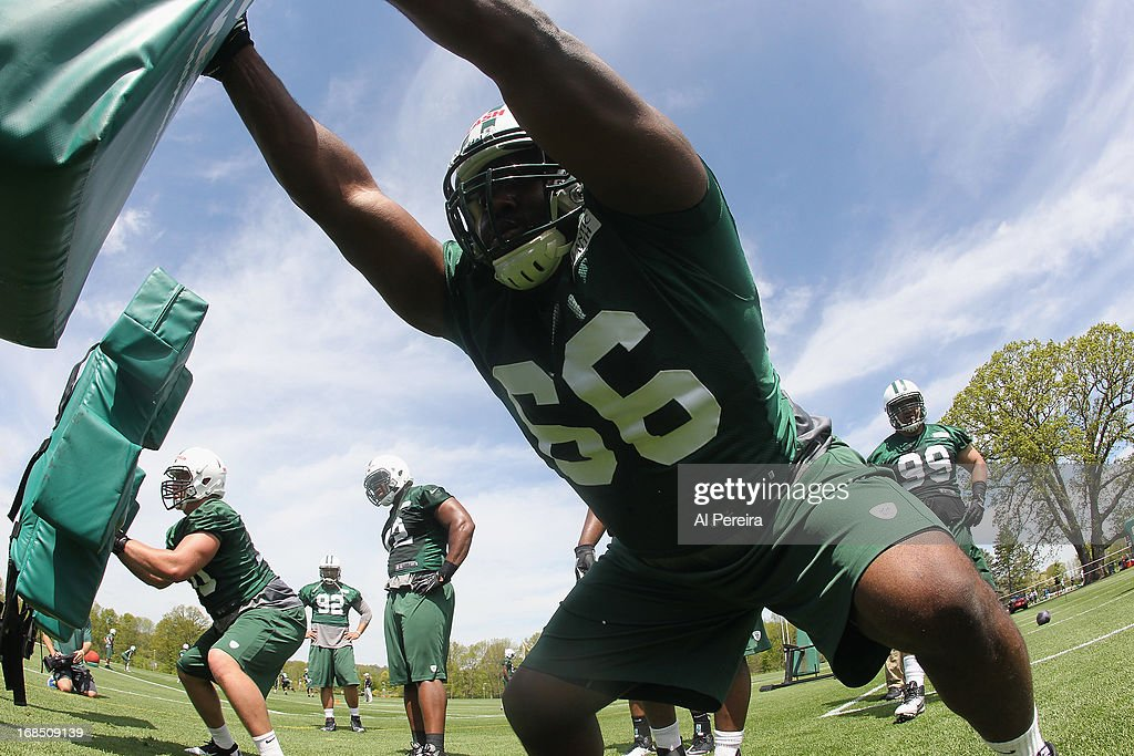 Defensive Tackle Justin Blash #66 of the New York Jets hits the sled during New York Jets Rookie Minicamp on May 10, 2013 at the Atlantic Health Jets Training Center in Florham Park, New Jersey.