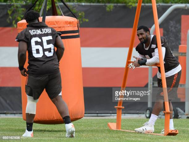Defensive tackle Larry Ognjobi of the Cleveland Browns talks with linebacker Nate Orchard after an OTA practice on June 6 2017 at the Cleveland...