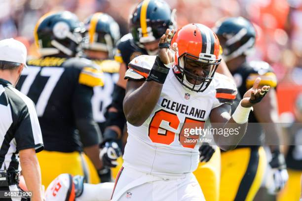 Defensive tackle Larry Ogunjobi of the Cleveland Browns celebrates after a play during the first half against the Pittsburgh Steelers at FirstEnergy...