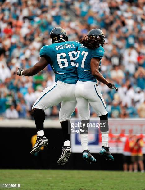 Defensive tackle Leger Douzable and cornerback Rashean Mathis of the Jacksonville Jaguars celebrate after stopping the Philadelphia Eagles on a...