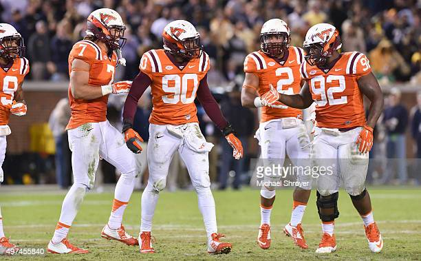 Defensive tackle Luther Maddy defensive end Dadi Nicolas and tight end Bucky Hodges of the Virginia Tech Hokies react following a fumble recovery...