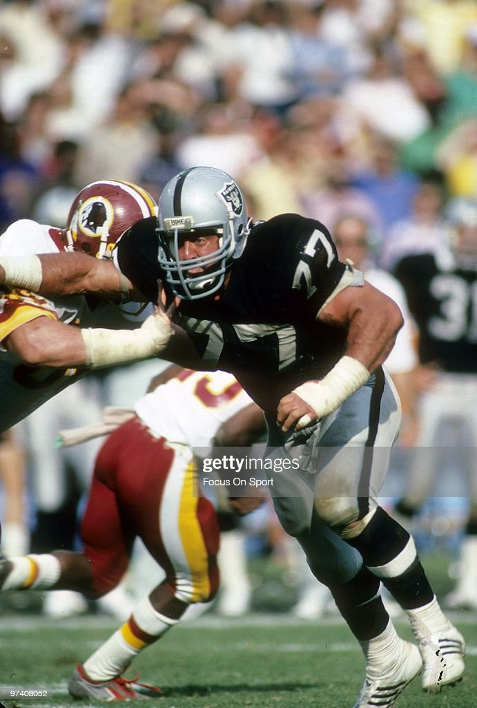 Defensive Tackle <a gi-track='captionPersonalityLinkClicked' href=/galleries/search?phrase=Lyle+Alzado&family=editorial&specificpeople=544733 ng-click='$event.stopPropagation()'>Lyle Alzado</a> #77 of the Los Angeles Raiders in action against the Washington Redskins October 2, 1983 during an NFL football game at RFK Stadium in Washington, D.C.. Alzado played for the Raiders from 1982-85.