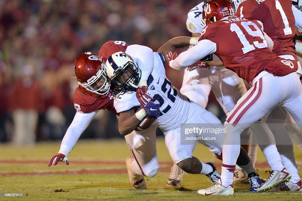 Defensive tackle Matt Romar #92 of the Oklahoma Sooners tackles tailback Aaron Green #22 of the TCU Horned Frogs during their win on November 21, 2015 at the Gaylord Family Oklahoma Memorial Stadium in Norman, Oklahoma.