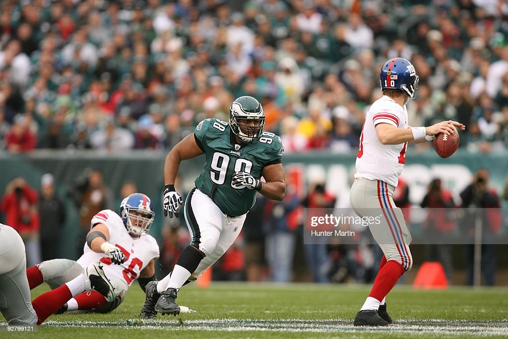 Defensive tackle Mike Patterson of the Philadelphia Eagles rushes quarterback Eli Manning of the New York Giants during a game on November 1 2009 at...