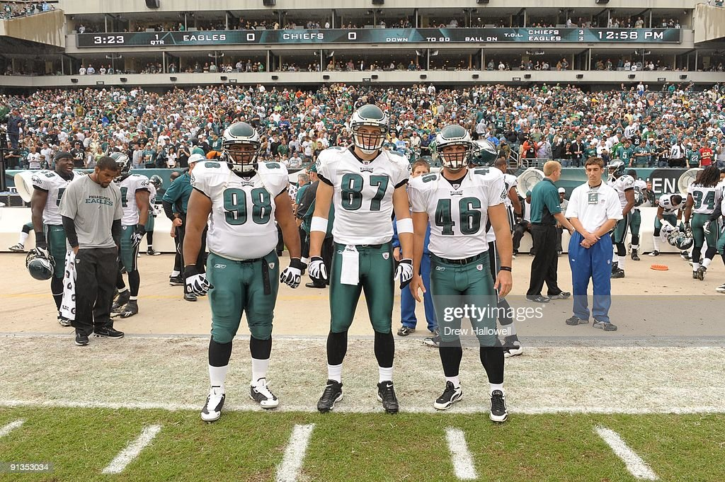 Defensive tackle Mike Patterson tight end Brent Celek and center Jon Dorenbos of the Philadelphia Eagles pose for the captains photo during the game...