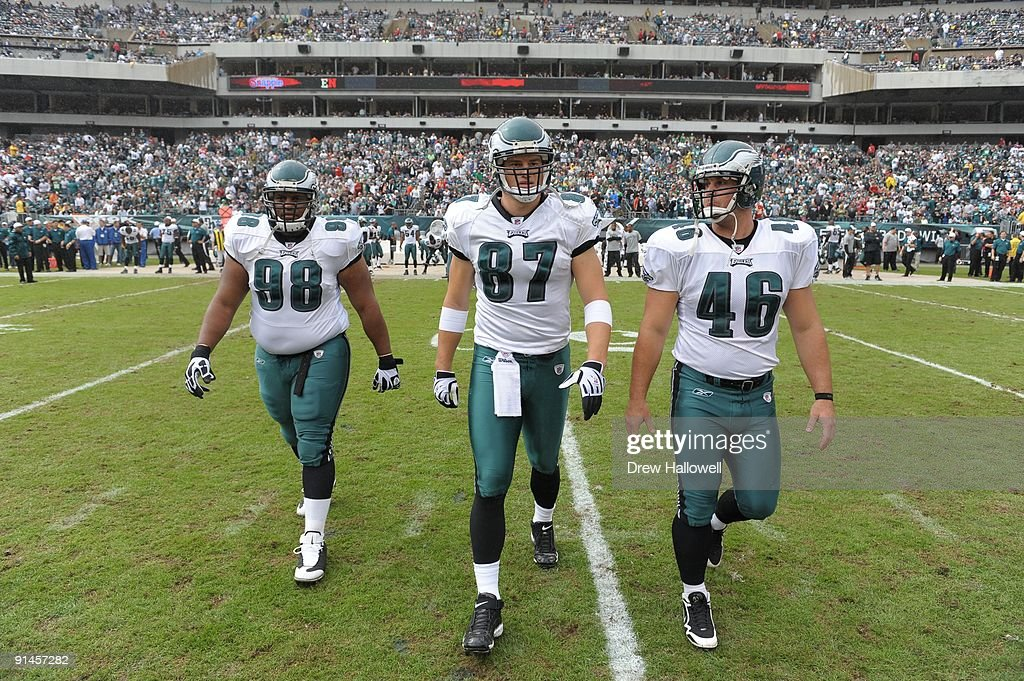 Defensive tackle Mike Patterson tight end Brent Celek and center Jon Dorenbos of the Philadelphia Eagles walk out for the coin toss during the game...