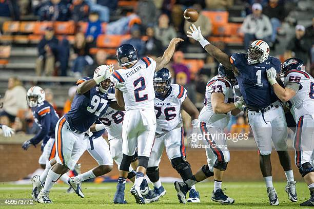 Defensive tackle Montravius Adams of the Auburn Tigers attempts to block a pass by quarterback Michael Eubank of the Samford Bulldogs on November 22...