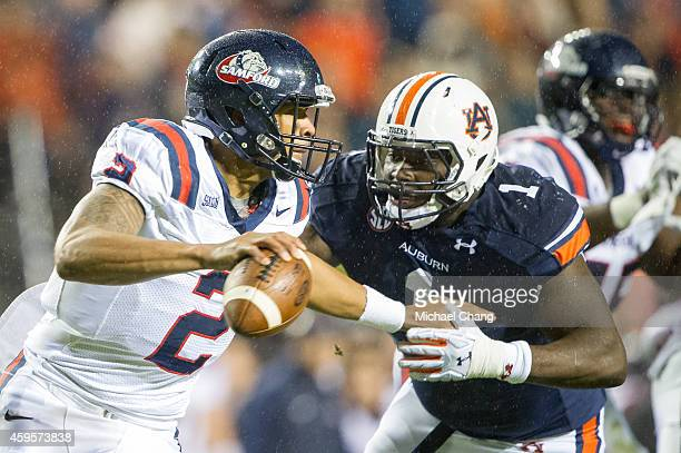 Defensive tackle Montravius Adams of the Auburn Tigers looks to tackle quarterback Michael Eubank of the Samford Bulldogs on November 22 2014 at...