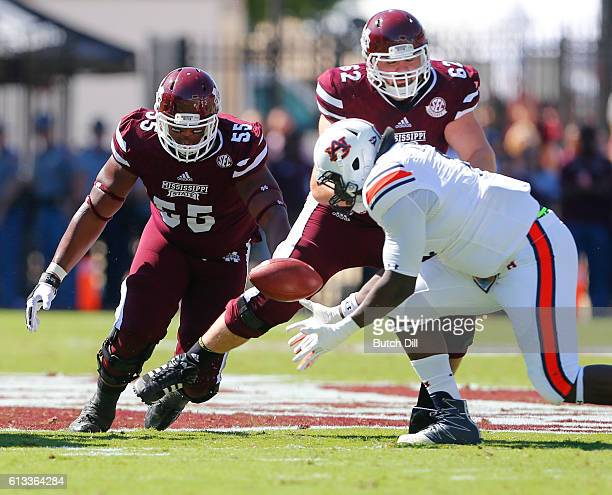 Defensive tackle Montravius Adams of the Auburn Tigers recovers a fumble before offensive lineman Martinas Rankin and offensive lineman Devon Desper...