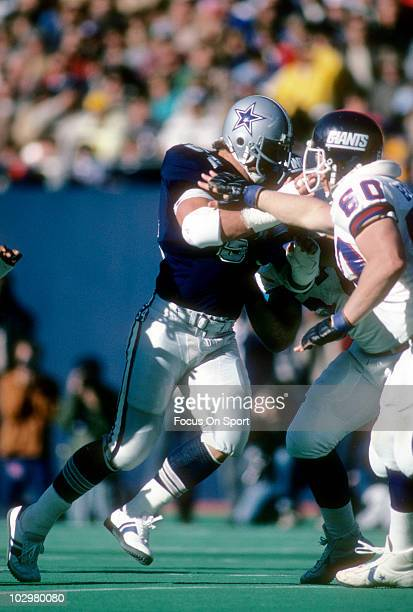 Defensive Tackle Randy White of the Dallas Cowboys in action against guard Billy Ard of the New York Giants December 11 1983 during an NFL football...
