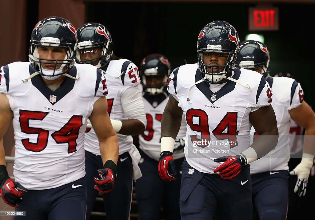 Defensive tackle Ricardo Mathews of the Houston Texans runs out onto the field before the preseason NFL game against the Arizona Cardinals at the...