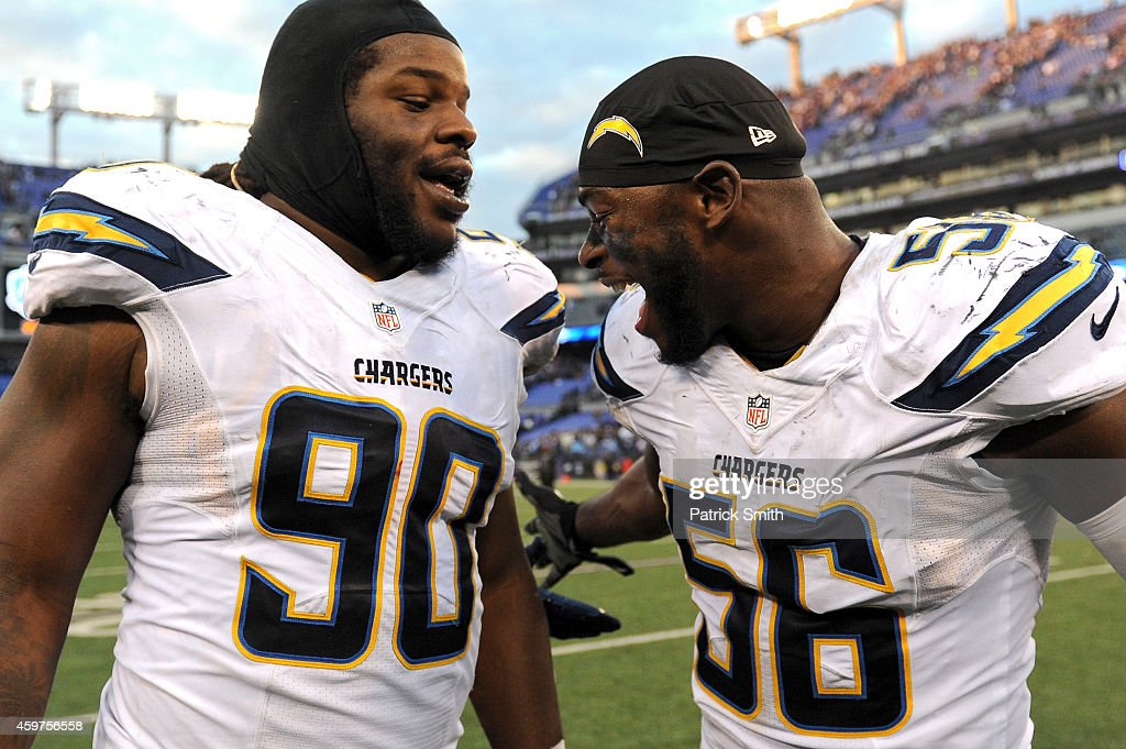 Defensive tackle Ricardo Mathews of the San Diego Chargers and inside linebacker Donald Butler of the San Diego Chargers celebrate after defeating...