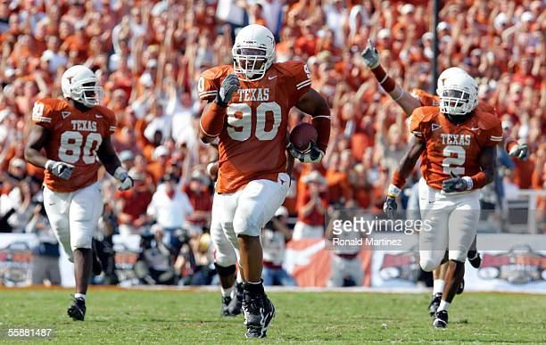 Defensive tackle Rodrique Wright of the Texas Longhorns runs a 67yard fumble return for a touchdown against the Oklahoma Sooners on October 8 2005 at...