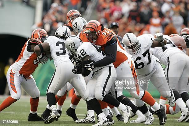 Defensive tackle Sam Adams of the Cincinnati Bengals tackles running back ReShard Lee of the Oakland Raiders on December 10 2006 at Paul Brown...