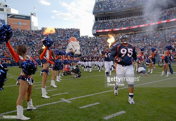 Defensive tackle Sam Adams of the Denver Broncos runs out with the the team before the preseason football game against the Cleveland Browns on August...