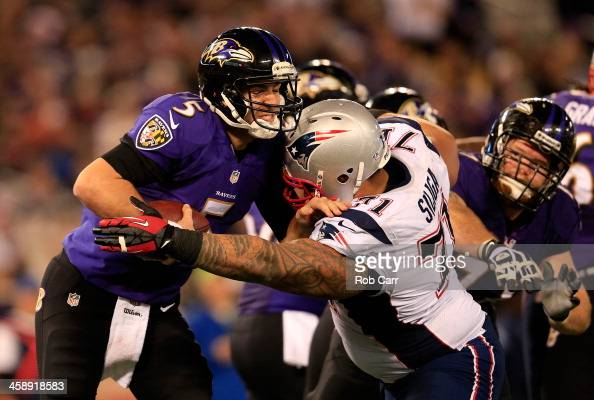 Defensive tackle Sealver Siliga of the New England Patriots sacks quarterback Joe Flacco of the Baltimore Ravens during the second half of the...