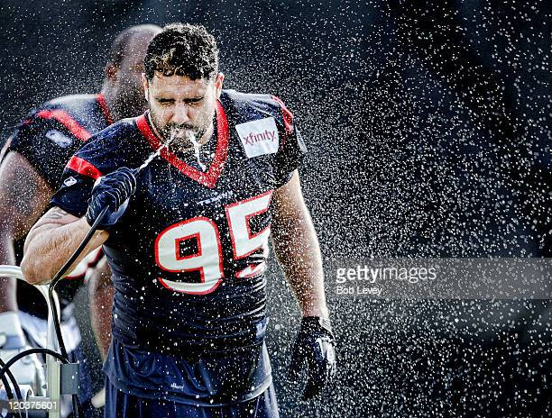 Defensive tackle Shaun Cody of the Houston Texans cools off during morning training camp practice at the Methodist Training Center at Reliant Park on...
