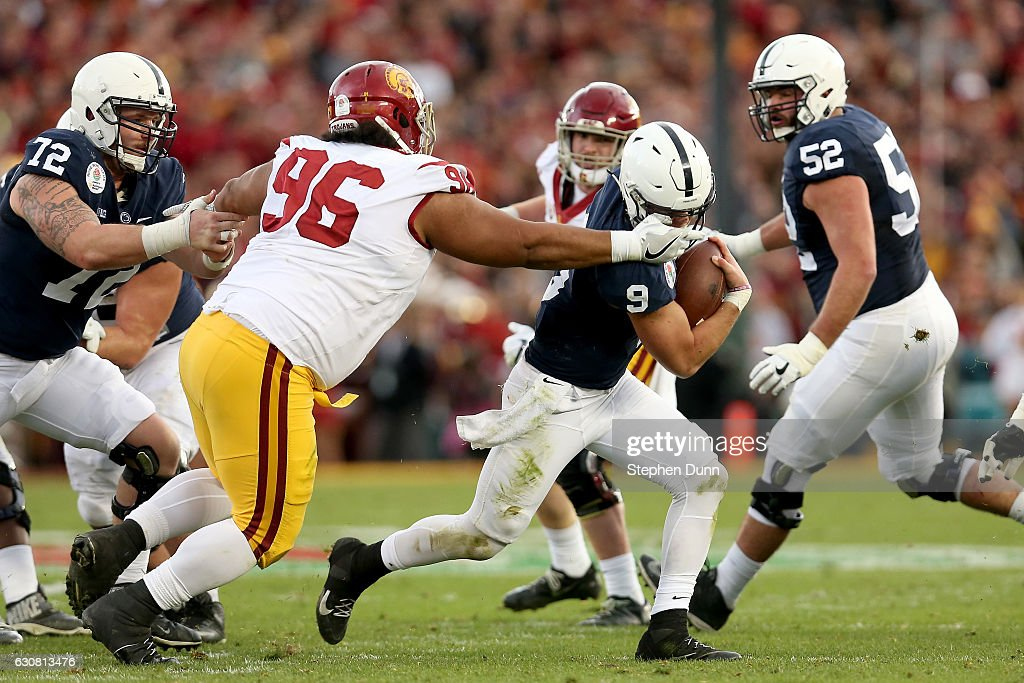 Defensive tackle Stevie Tu'ikolovatu #96 of the USC Trojans attempts to tackle quarterback Trace McSorley #9 of the Penn State Nittany Lions in the first half of the 2017 Rose Bowl Game presented by Northwestern Mutual at the Rose Bowl on January 2, 2017 in Pasadena, California.