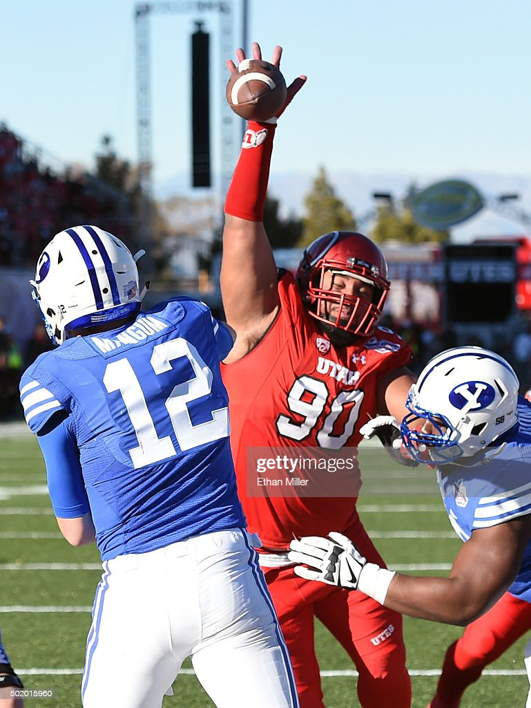 Defensive tackle Stevie Tu'ikolovatu #90 of the Utah Utes blocks a pass by quarterback Tanner Mangum #12 of the Brigham Young Cougars during the Royal Purple Las Vegas Bowl at Sam Boyd Stadium on December 19, 2015 in Las Vegas, Nevada.