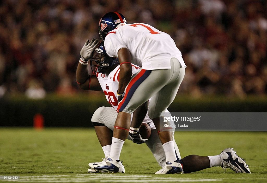 Defensive tackle Ted Laurent #99 of the Mississippi Rebels celebrates after recovering a fumble during their game against the South Carolina Gamecocks at Williams-Brice Stadium on September 24, 2009 in Columbia, South Carolina.