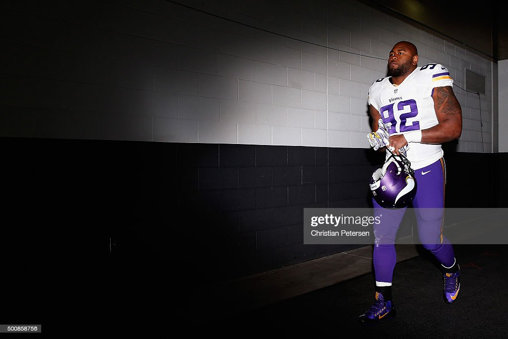 Defensive tackle Tom Johnson of the Minnesota Vikings takes the field before the NFL game against the Arizona Cardinals at the University of Phoenix...