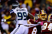 Defensive tackle Tony McDaniel of the Seattle Seahawks has his waistband pulled in the first half of a game against the Washington Redskins at...