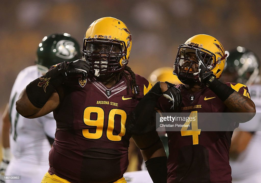 Defensive tackle Will Sutton #90 and safety Alden Darby #4 of the Arizona State Sun Devils celebrate after a defensive stop against the Sacramento State Hornets during the first quarter of the college football game at Sun Devil Stadium on September 5, 2013 in Tempe, Arizona.