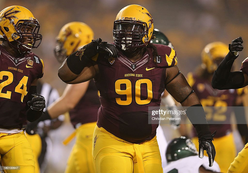 Defensive tackle Will Sutton #90 of the Arizona State Sun Devils reacts after a defensive stop against the Sacramento State Hornets during the first quarter of the college football game at Sun Devil Stadium on September 5, 2013 in Tempe, Arizona.