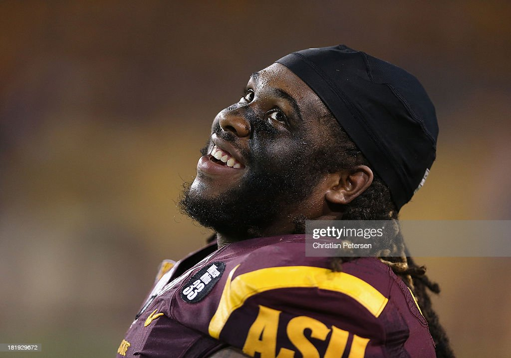 Defensive tackle Will Sutton #90 of the Arizona State Sun Devils reacts on the sidelines during the college football game against the Sacramento State Hornets at Sun Devil Stadium on September 5, 2013 in Tempe, Arizona.