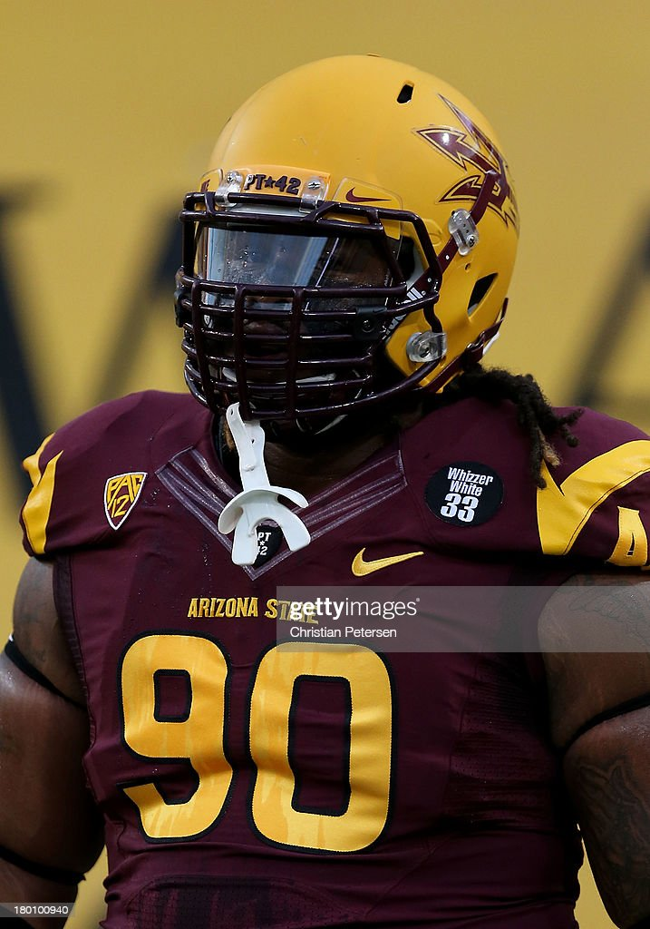 Defensive tackle Will Sutton #90 of the Arizona State Sun Devils warms up before the college football game against the Sacramento State Hornets at Sun Devil Stadium on September 5, 2013 in Tempe, Arizona.