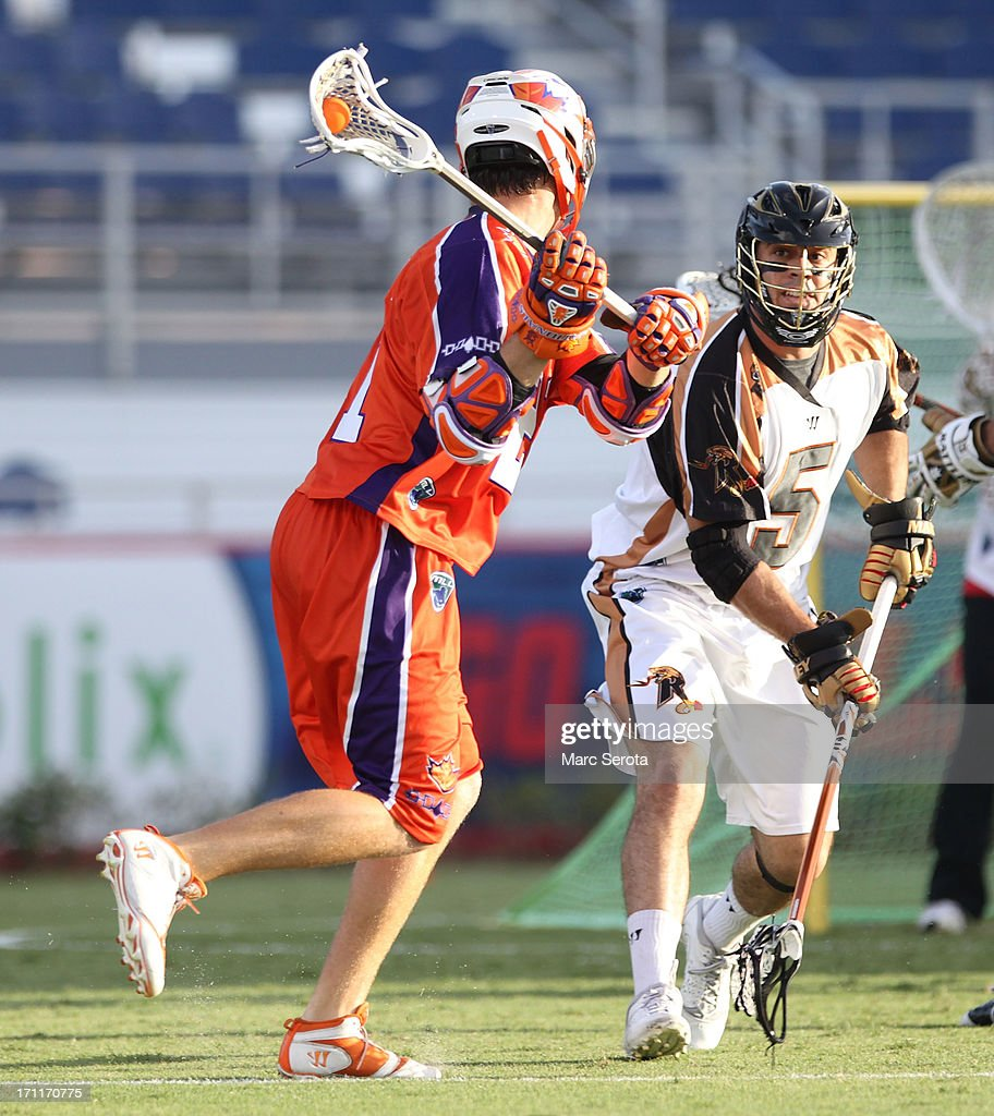 Defensman Mike Manley #5 of the Rochester Rattlers defends against Attacker Kevin Crowley #21 of the Hamilton Nationals during the second quarter against the Rochester Rattlers at FAU Stadium on June 22, 2013 in Boca Raton, Florida. The Nationals defeated the Rattlers 17-11.