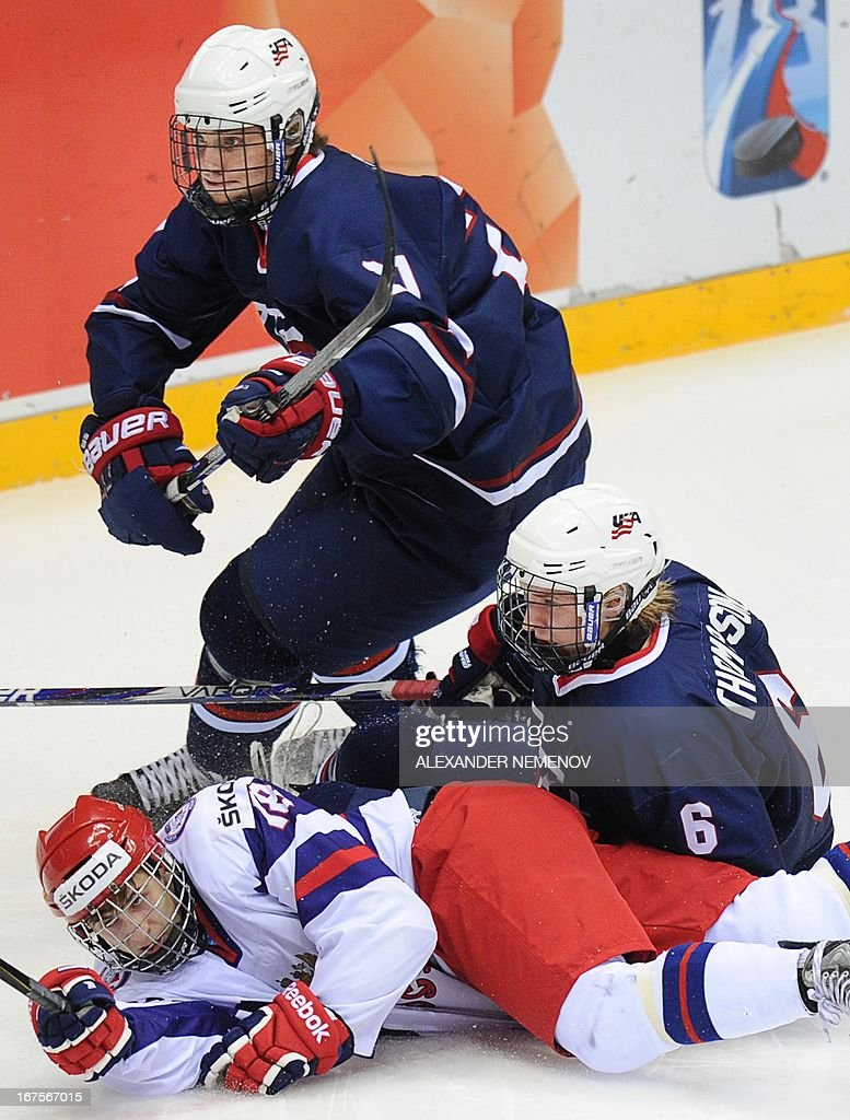 US defensmen Clint Lewis and Keaton Thomson vie with Russia's forward Vyacheslav Leshenko during a semifinal game of the IIHF U18 International Ice...