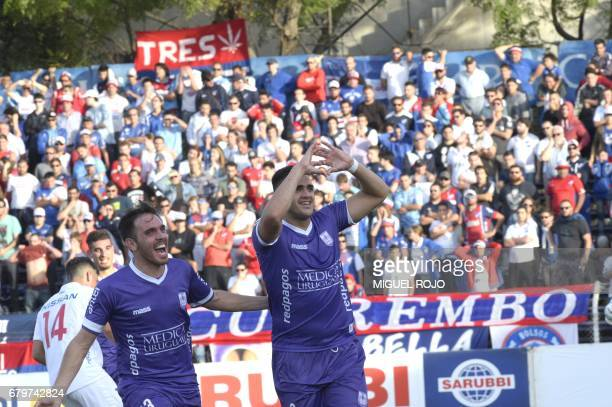 Defensor players Maximiliano Gomez and Gonzalo Bueno celebrate their second goal against Nacional during their match at the Franzini stadium in...