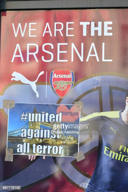 Defiant messages are stuck to the Arsenal football shop window on 19th June 2017 in London England PHOTOGRAPH BY Matthew Chattle/Barcroft Images...
