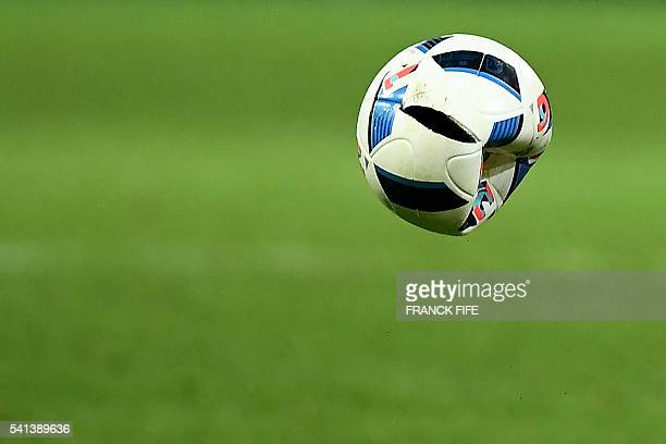 A deflated ball is kicked during the Euro 2016 group A football match between Switzerland and France at the PierreMauroy stadium in Lille on June 19...