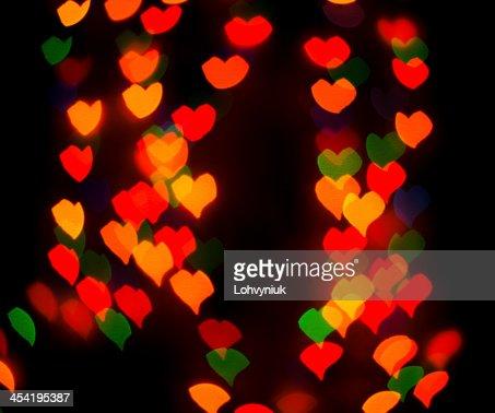 Sfocato bokeh sfondo di luci o in forma di cuore : Foto stock