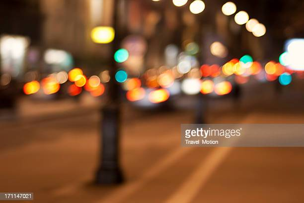 Defocused city street lights background in Paris, France