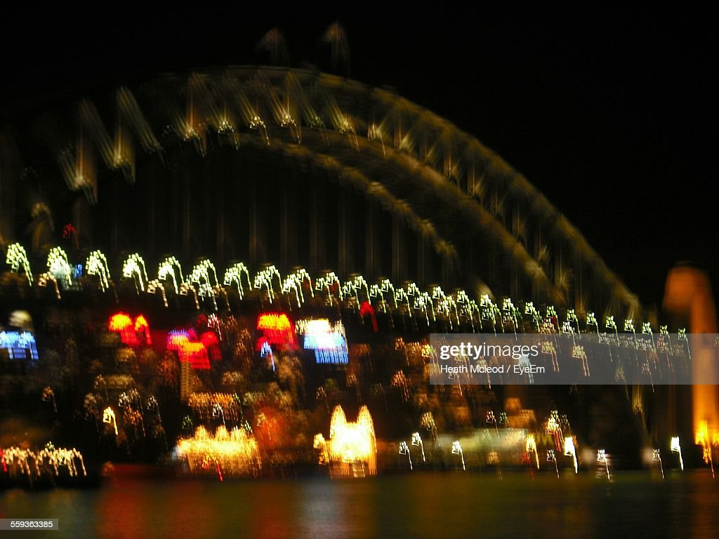 Defocused Illuminated Sydney Harbor Bridge At Night