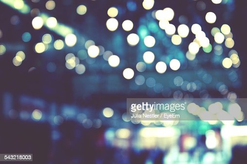 Defocused Image Of Christmas Lights In City
