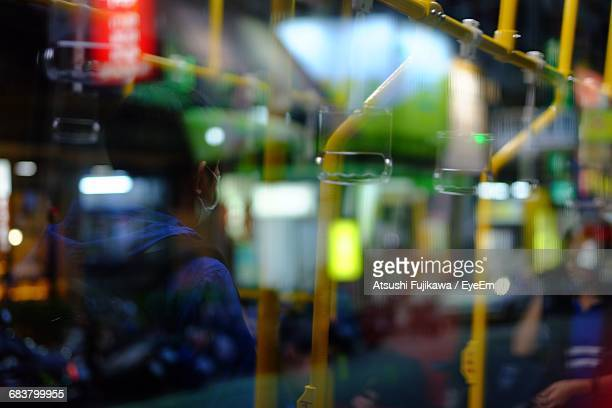 Defocused Image Of Person Standing In Bus