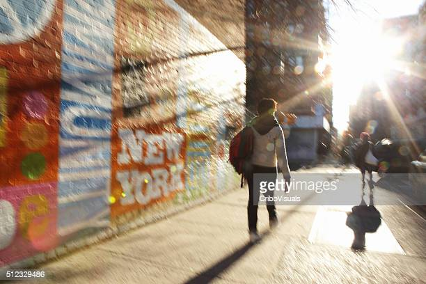 Defocused image of sun rising down a NYC street