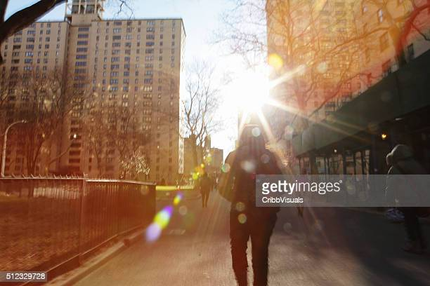 Defocused image of sun rising down a NYC street