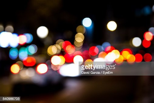 Defocused Image On Cars In Street At Night