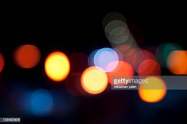 defocused light dots against black background